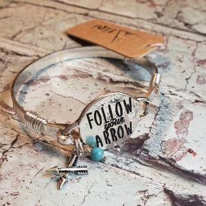 Jewelry - Silvertone wire wrapped follow your arrow bracelet